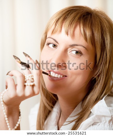 Portrait of 40 years old smiling woman with manicure