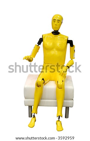 portrait of yellow crash test dummy sitting, isolated on white - stock photo