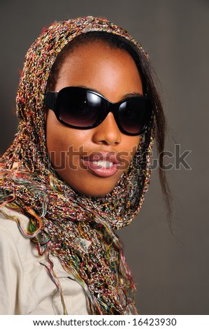 Portrait of yong trendy african female model with sunglasses - stock photo
