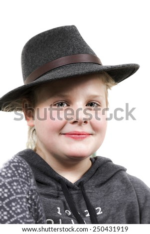 Portrait of youn teenager girl in black hat - stock photo