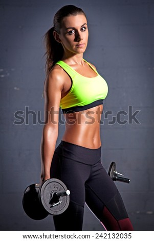 Portrait of young adult active sporty attractive sexy and sensuality beautiful brunette pretty woman at the gym - stock photo