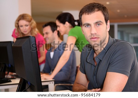 Portrait of young adult attending training class - stock photo