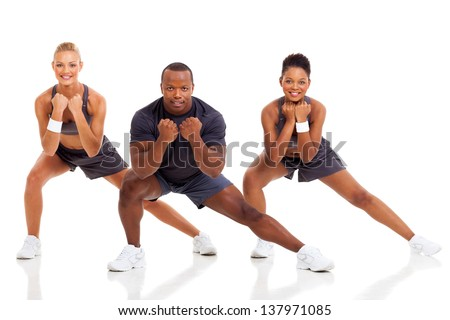 portrait of young adult exercising on white background - stock photo