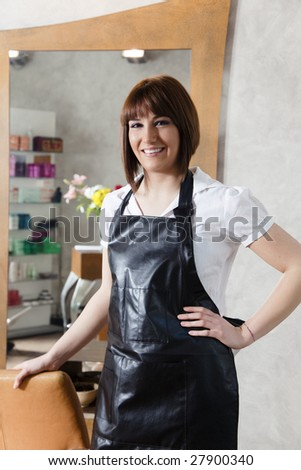 portrait of young adult hairstylist looking at camera - stock photo