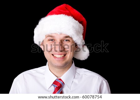 portrait of young adult happy smiling male with santa cap, studio shoot isolated on black