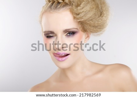 Portrait of young adult  pretty woman with beautiful blond hairs and pink lips isolated on white background