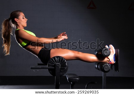 Portrait of young adult sporty attractive sexy and sensuality beautiful brunette pretty woman at the gym - stock photo
