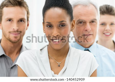 Portrait Of Young African American Businesswoman With Business Team - stock photo
