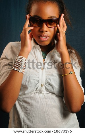 Portrait of young african american fashion woman with sunglasses - stock photo