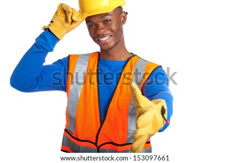 Portrait of young African-American male construction worker shaking hand and tipping his hardhat, studio shot - stock photo