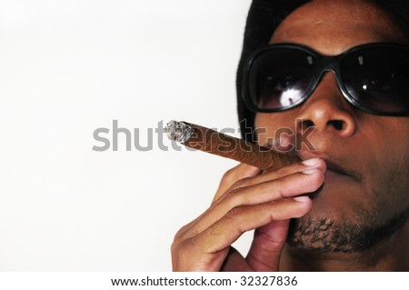 Portrait of young african american man smoking cigar - isolated - stock photo