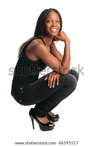 Portrait of young African American woman in casual clothes isolated over white background - stock photo