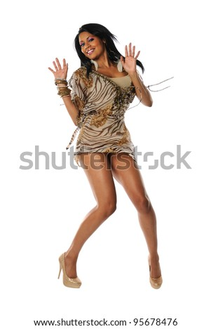 Portrait of young African American woman jumping isolated over white background - stock photo