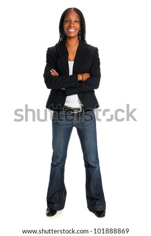 Portrait of young African American woman smiling with arms crossed isolated over white background