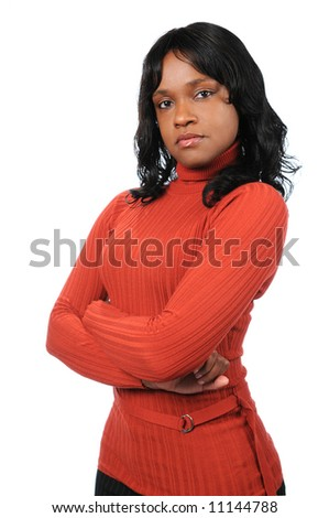 Portrait of young African American woman with arms folded. - stock photo