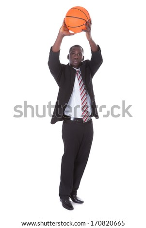 Portrait Of Young African Businessman Playing Basketball - stock photo