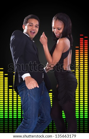 Portrait Of Young African Couple Dancing Over Equalizer Background - stock photo
