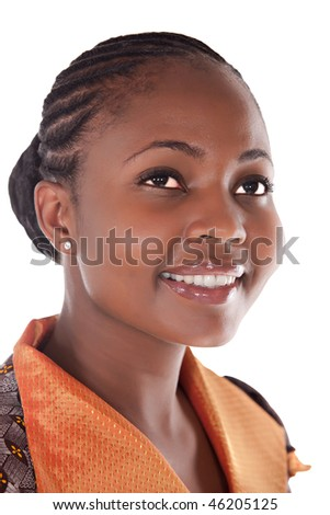 portrait of young african girl with orange, brown top - stock photo