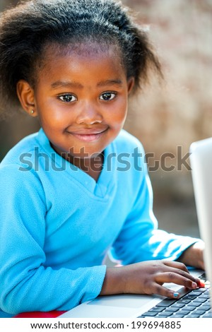 Portrait of young African student learning with laptop. - stock photo