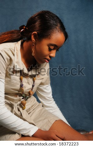 Portrait of young african teenage girl reclining - stock photo
