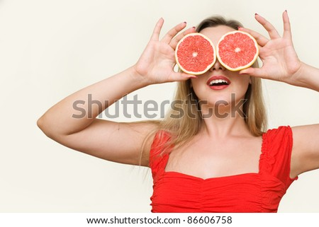 Portrait of young and attractive girl with Grapefruits