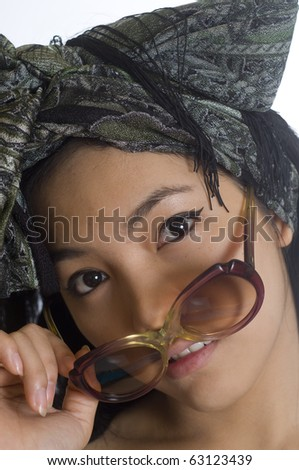 Portrait of young and beautiful Asian woman with sunglasses and scarf on her head - stock photo