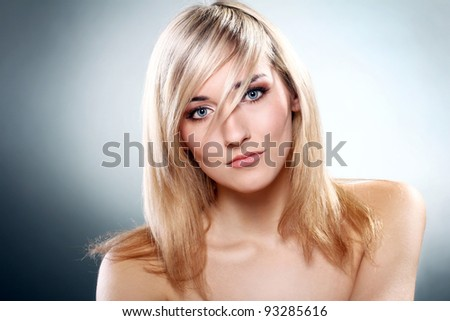 Portrait of young and beautiful blonde - stock photo