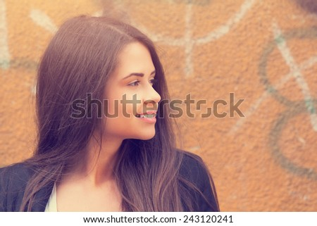 Portrait of young and beautiful brunette. - stock photo