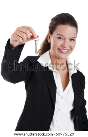 Portrait of Young and beautiful businesswoman holding keys, focus is on the keys - stock photo