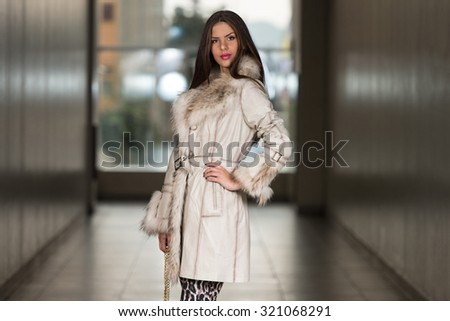 Portrait Of Young And Beautiful Fashion Model In The Shopping Mall