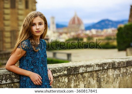 Portrait of young and beautiful girl in Florence, Italy. In background Cathedral Santa Maria del Fiore - stock photo