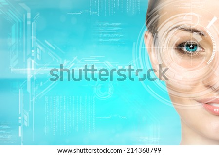 portrait of young and beautiful woman with the virtual hologram on her eyes (laser medicine and security technology concept) - stock photo