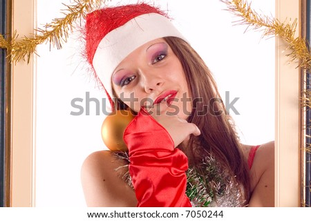 Portrait of young and pretty santa girl