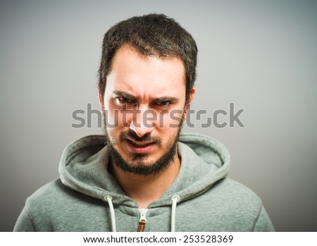 portrait of young angry man - stock photo