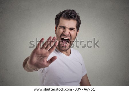 portrait of young angry man screaming to stop stay away  - stock photo