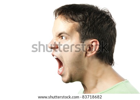 portrait of young angry man sreaming isolated on white background - stock photo