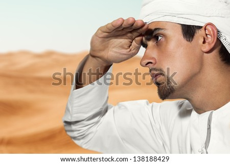 Portrait of young Arab in the desert. - stock photo