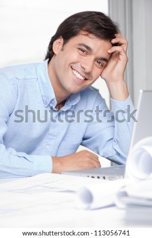 Portrait of young architect at workplace. - stock photo