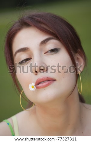 portrait of young arrogant girl outdoors - stock photo