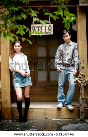 Portrait of young artistic couple in romantic emotion - stock photo