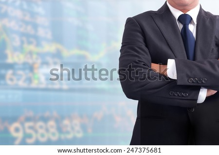 Portrait of young asia business man has stock market background .cross one's arm, - stock photo