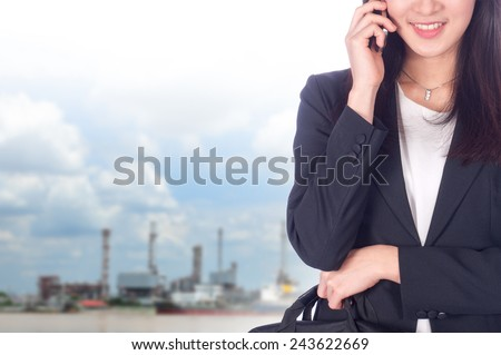 Portrait of young asia business woman has oil industry background.Mixed Asian / Caucasian businesswoman. - stock photo