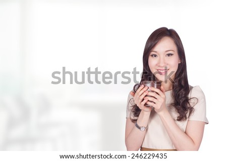 Portrait of young asia business woman hold coffee cup in her office.Mixed Asian / Caucasian businesswoman. - stock photo