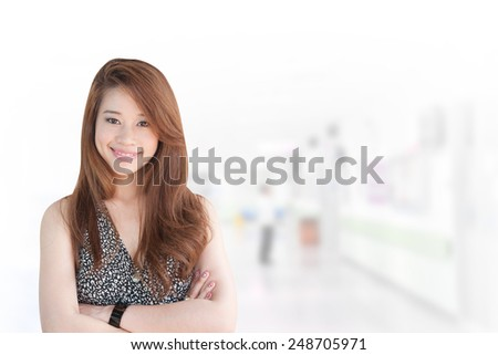 Portrait of young asia business woman 20 -30 year hold banner old in her office. Mixed Asian / Caucasian businesswoman. Positive emotion - stock photo