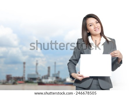 Portrait of young asia business woman 20 -30 year old and hold banner in her office.Mixed Asian / Caucasian businesswoman.Positive emotion - stock photo
