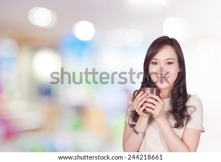 Portrait of young asia business woman 20-30 year old hold cup of coffee in shopping mall.Mixed Asian / Caucasian businesswoman. - stock photo