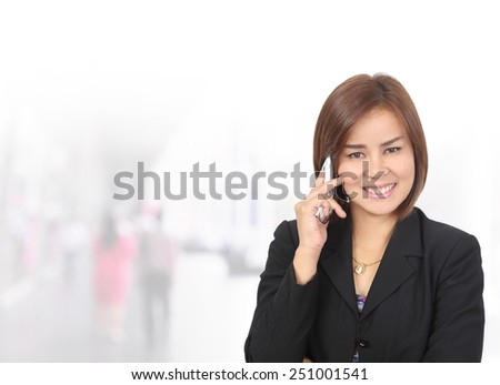 Portrait of young asia business woman 30 - 40 year old use phone in her office.Mixed Asian / Caucasian businesswoman.