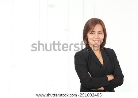 Portrait of young asia business woman 30 - 40 year old use phone in her office.Mixed Asian / Caucasian businesswoman. - stock photo