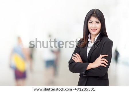 portrait of young asia business woman 20-30 years old her office background ,Mixed Asian / Caucasian businesswoman.