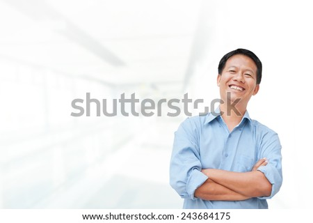 Portrait of young asia businessman in office - stock photo